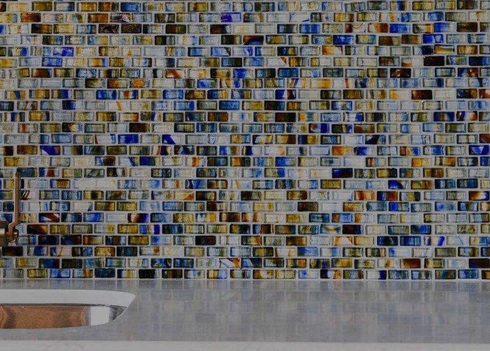 Beautiful, full of color tile backsplash on an outdoor kitchen.