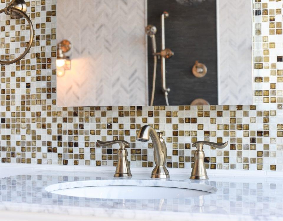 Beautiful bathroom sink faucet from Facets of Lafayette's showroom. Tile backsplash in background
